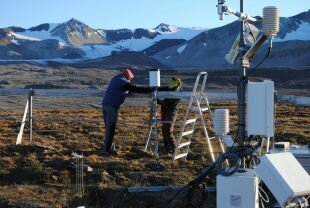 """Stephan and Julia calibrating the precipitation gauge"""